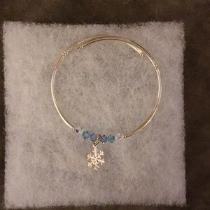 Jewelry - Silver toned bracelet with snowflake charm